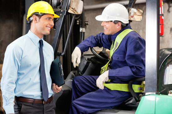 Forklift Driver Communicating With Supervisor